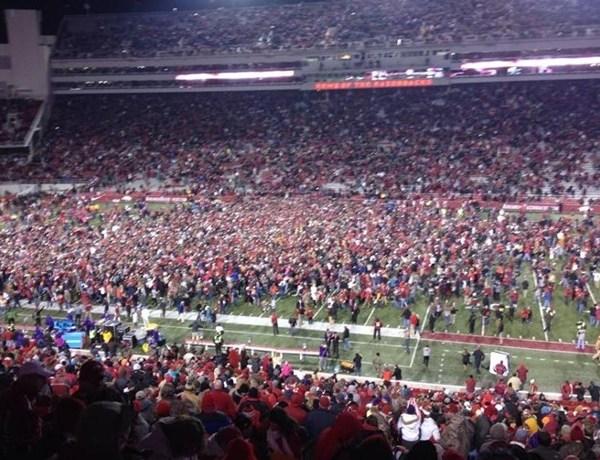 Razorback fans on field after LSU win_-5813795026922356124