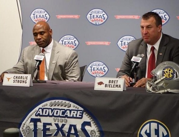 UT's Charlie Strong and UA's Bret Bielema at Texas Bowl news conference._3874772377079660872