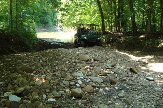Gravel-filled roadbed at Erbie area crossing, Buffalo National River._-1920336508605149197