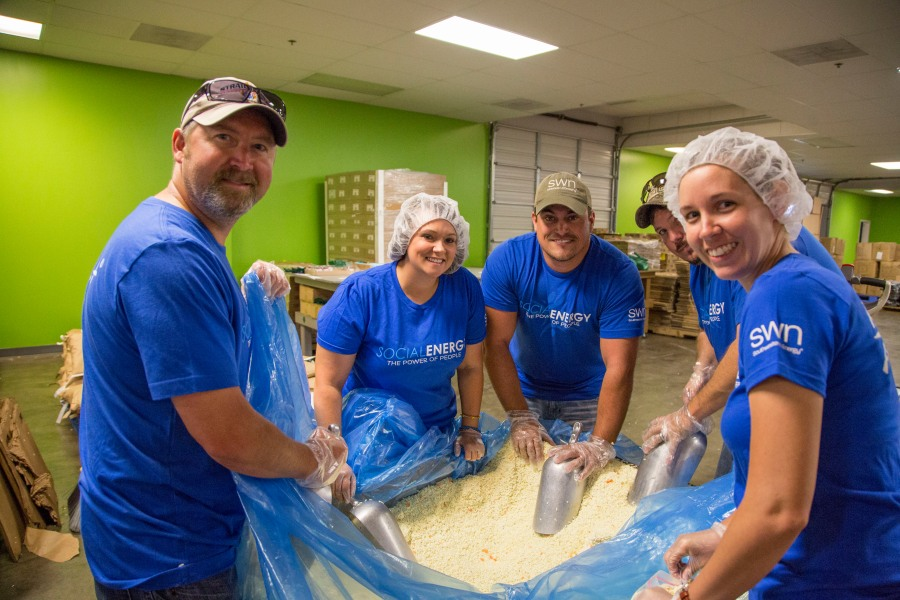 Southwestern Energy Company Employees Pack Meals at Ark  Rice Depot