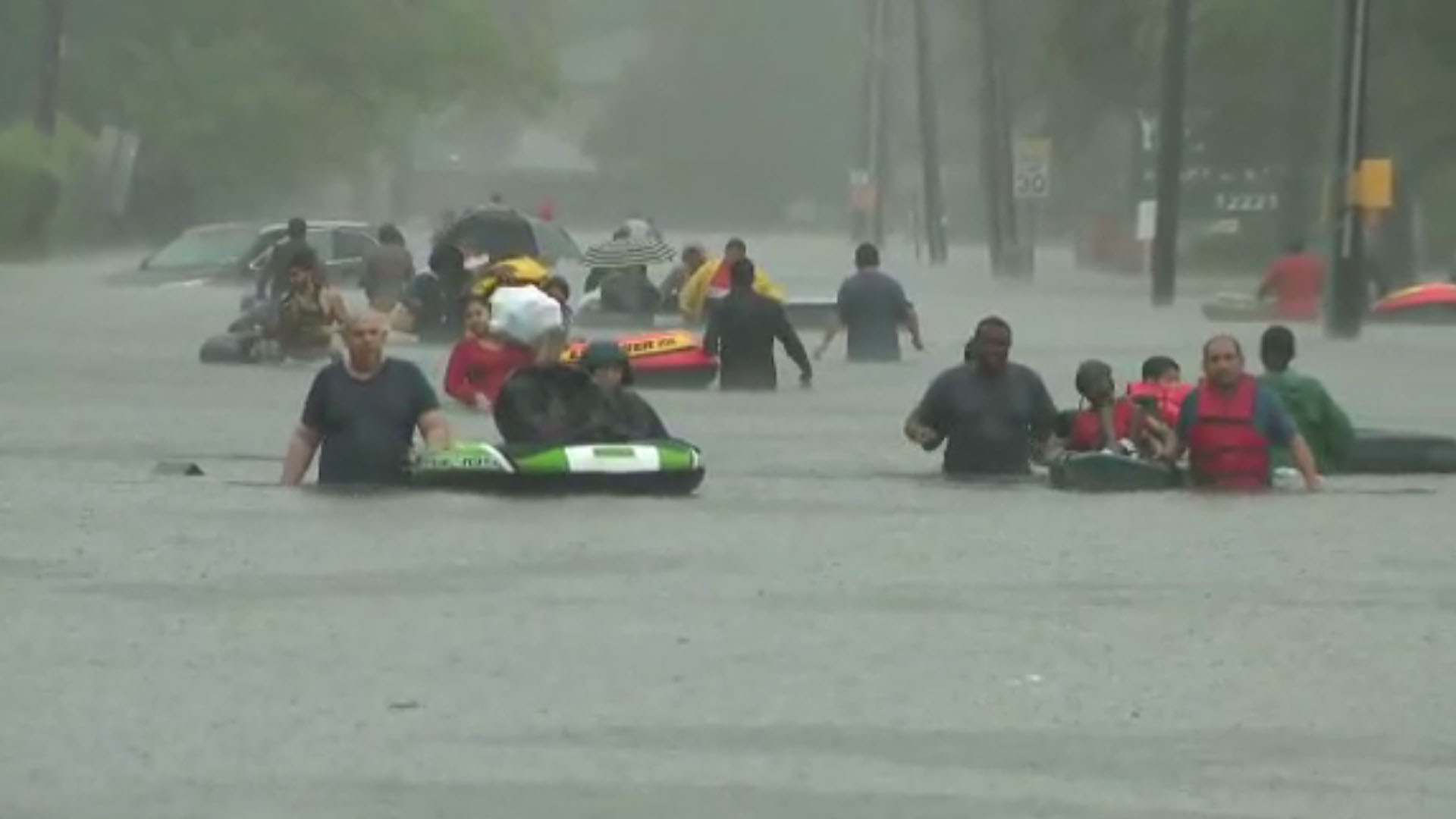 Evacuees escape flooding in Houston, Harvey, screenshot_1503847907619-159532.jpg15097042