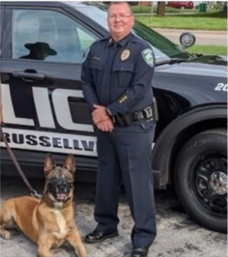 This image has an empty alt attribute; its file name is Russellville-K-9.png